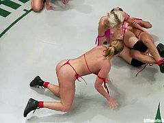 Four horny bitches enjoy wrestling with each other on tatami