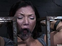 Big-breasted brunette Claire Dames gets chained and tortured by Sgt. Major in a basement. Major fingers Claire's cunt and then rubs it hard with a dildo till the bitch cums.