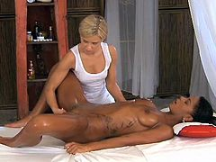 Adorable Black girl gets massaged and oiled up by White babe. Later on chocolate girl spreads her legs and gets fingered.
