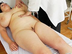 Check out this chunky whore! She's at her doc for a complete examination and damn, the doc really gives his best in checking her out! After measuring her big boobs he asks her to lay on her back and spread her legs. Then, the doctor gapes her shaved pussy and show it to us. Maybe he will check her insides too.