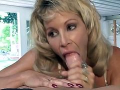 Nasty blonde woman gives skillful blowjob to a barmen. She sucks his dick with great pleasure and also gets her face cum covered.