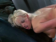 This delicious cougar with big tits gets fucked hard in a garage. Her man makes her scream and moan with his big stiff cock, as he pounds her cunt.