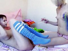 Alice with small tits and hairless snatch having sensual lesbian sex with Beata