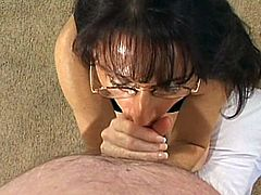 A horny brunette mom is trying her best to satisfy her man. She kneels in front of him and begins to suck and rub his dick. She does it like never before and they both enjoy it much.