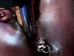 Watch this horny black babe geting poked with all kinds of dildos in her wet and tight backholes in Harmony Vision sex clips.