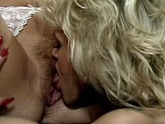 Two voluptuous lesbians are going wild on the boss's table. Vintage brunette girls spreads her legs wide open and enjoys pussy eating by blonde girlfriend.