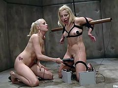 Sexy blonde chick gets tied up and gagged by the mistress. Then Ashley gets her tits wired and pussy toyed with a vibrator. Ashley also licks Lorelei's vagina with pleasure.