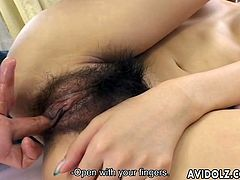 Adorable Japanese chick lies on a bed. She gets her bushy vagina fingered. Then she gives sloppy blowjob with great pleasure.