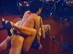 Lucky blonde babe gets really brazen on the stage with male stripper. She's all naked gives him blowjob, rides his big dick on top and gets furiously fucked missionary style.