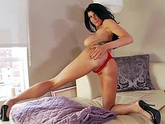 Man, what a charming and sizzling doll Romi Rain is! She gets a huge dildo and it moves deep in her beaver! Her tattoos are so sexy!