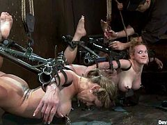Darling and her friend are playing dirty games with sexy mistress Isis Love in a basement. Isis puts the sluts into irons and plays with their big tits and wet cunts.