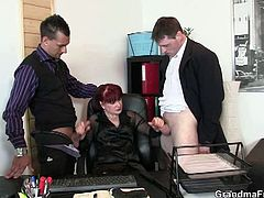 Two young guys visit an old redheaded lady at her office. Regardless of their initial purpose there, they end up getting their dicks sucked by this old slut.