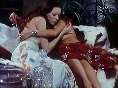 Two magnificent lesbians start kissing on the couch and take their clothes off. Redhead hottie goes down on her big boobed bitch licking her tasty hairy pussy with joy.