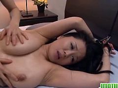 Miki Sato is a horny Japanese milf with juicy tits and tight hairy twat. She is all tied up to the bed and a young dude sticked his stiff cock deep into her cunt!