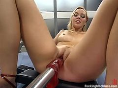 Gorgeous blonde Annette Schwarz is having fun with a fucking machine indoors. She takes the device into her vag and gets it drilled remarcably well.