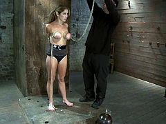 Pigtailed blonde girl with big boobs gets undressed and tied up by her master. Later on she gets her tits twisted.