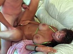 That stud licks her slimy hairy hole and prepares it for his long and stiff prick, this nasty MILF is doing titjob to that fucker before wild banging.