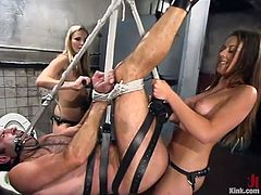 Harmony and Penny Flame tie up and suspend a guy. Then they whip and spank him. Later on he gets his ass destroyed with a strap-on.
