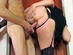 This retro dressed brunette goes down on his cock and sucks and then gets her nice looking ass drilled in this free tube sex movie.