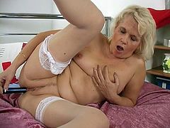 This blonde granny is in her lingerie and gets horny so rubs her pussy and then uses a dildo to get her pleasure in this free tube video.