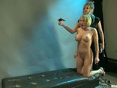 Busty blonde Krissy Lynn gets restrained by Maitresse Madeline. Maitresse decorates Krissy's big natural tits with clamps and then beats the blonde and rips her cunt apart with a strapon.