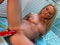 Damn, she is a beauty queen and man, she is so fucking steaming! Babe reveals her pussy for you and tickles it with a dildo.