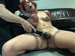 Sexy redhead chick Renee Broadway is playing dirty games with some man indoors. She lets him tie her up and then moves her legs wide apart, letting the man rub her snatch with a toy.