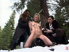 Three nasty vixens are going to dominate and torture a blonde chick outdoors, even placing her on top of the sybian they brought.