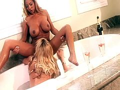 Hardcore tanned chicks in a hot fisting scene