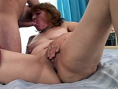 Grandma was rubbing her fat, shaved pussy when this dude came in and gave her his cock. She lustfully opened her mouth and started to suck his penis. Granny did such a great job with her lips that she earned to right to get fucked. So, our saggy slut bent over and received a deep pussy fuck from behind that made her moan.