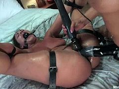 Charley Chase and Isis Love are playing dirty games in the bedroom. Isis binds Charley and smashes her pussy with a huge dildo and they both enjoy it much.