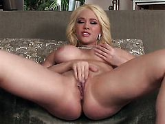 With giant tits and hairless muff spends time fingering her snatch