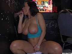 Lisa Ann is a super sexy milf with huge boobs and bubble ass. She shows off her curvy body as she gets fucked through a glory hole. Watch passionate experienced brunette Lisa Ann do it.