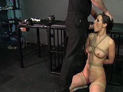 Bondage Master brings his cute asian sub girl to a long intense orgasm by toying her tight pussy with big vibrating toy and then she shoves his big cock in hr mouth to make her gag hard.