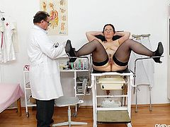 Although Dorotha is an old pussy, she's still tight and juicy. The brunette mature came at her doc for a routine exam, made herself comfortable on the gynecologist table and relaxed. The old doc gape her snatch and then inserted a plastic speculum in her vagina. Yeah, look at her inside now!