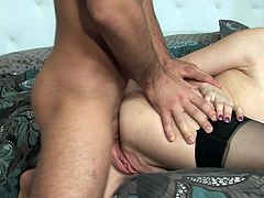 This insatiable cougar in sexy black stockings wants to get really wild with this stud's dick! She sucks his swollen pecker with great enthusiasm paying special attention to his balls. Then he fucks her from behind.