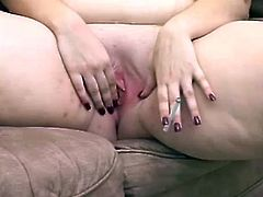 Salacious blonde fattie is having fun in the living room. She kneads her massive boobs and licks them and then entertains herself by finger-fucking her cunt.