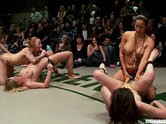 Four nasty girls fight fiercely in 2 versus 2 battle. Two losing chicks suck strap-ons and then get toyed right on a ring in public.