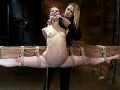 Pretty girl with flexible body gets undressed and tied up by her mistress. Then Sensi gets her shaved pussy toyed with a vibrator.