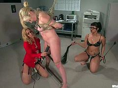 Two juicy office chicks are going to torture that sexy blond babe, who is new in the office. They tie her up and give her some pain at your work place.