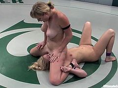 What a cruel battle is going on on the pitch between two smoking hot and slender babes! Adrianna Nicole is about to rip apart Hollie Stevens pussy with a strapon!