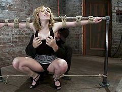 Slutty blonde milf Lily Labeau allows some guy to tie and hang her up in a basement. The dude rubs the skank's snatch with a dildo and enjoys the way she moans.