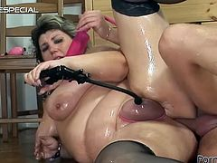 A pussy pump and a hard cock in her ass are going to make the day to this mature slut in stockings in this wild video.