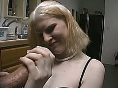 Blonde chick washes dishes and then pleases her boyfriend right in the kitchen. She drops to her knees and gives a handjob in POV video.