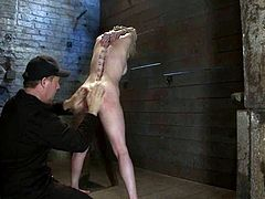 Horny blond siren is being hogtied and waxed