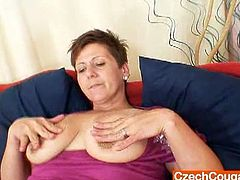 Hot amateur big titted granny Garyna spreads her hairy pussy for toying it hard and deep.Watch how this big titted Czech cougar in her stocking bend down to fuck her hairy cunt with a huge dildo.