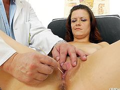 Whore Dzamila looks good for her age but she still wants to make sure that's she's in a good condition so she visit her local doc. The doc asks her to undress and take a sit on the gynecology table. There, he gapes her pussy really wide to check it out. The perverted doc goes even further and pinches it.