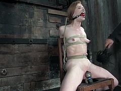 Redhead hottie Madison Young gets bound and suspended in a basement. Some man torments Madison and makes her cum a few times.