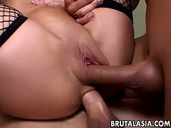 Roxy Jezel is an Asian skank who has a threeway with two guys who fuck her at the same time. They brutally double penetrate her holes, making her scream at every thrust.