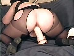 Man, this mature lady is wicked crazy! She puts on her erotic undies and a mask on her eyes. Then she spreads her legs to masturbate.